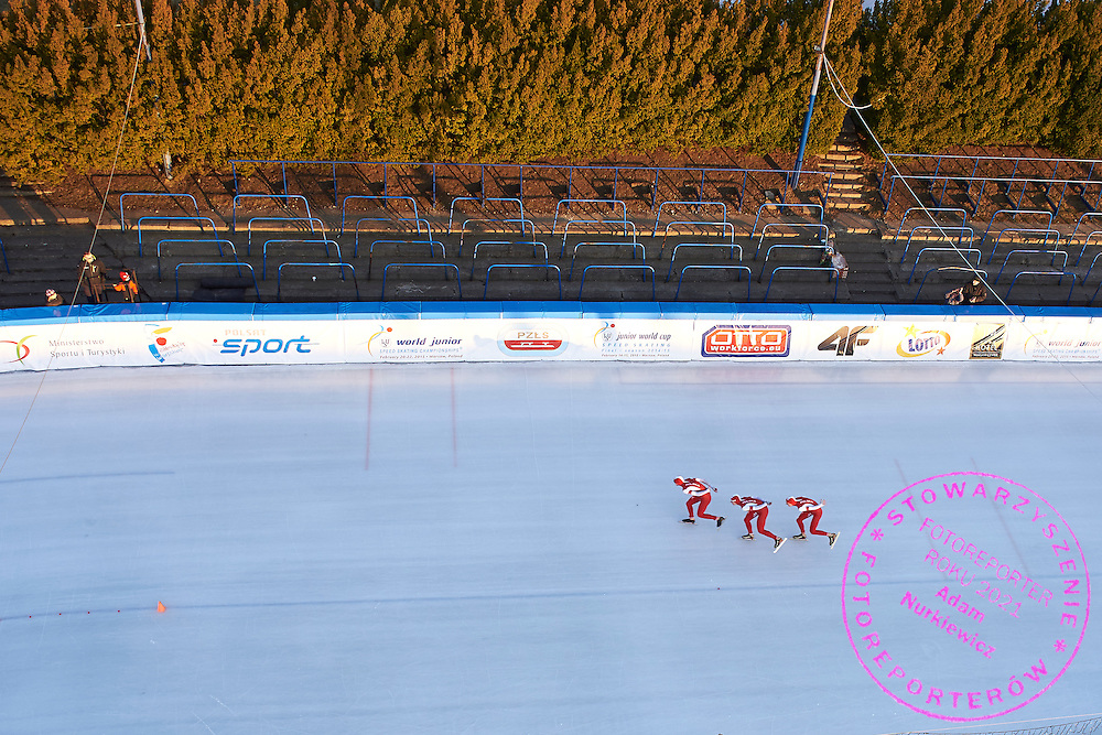 Team Poland (Marcin Bochanek and Dawid Burzykowski and Mateusz Owczarek) compete in Team Pursuit Men (8 laps) final during First Day of the ISU Junior World Cup Speed Skating on Stegny Ice Track on February 14, 2015 in Warsaw, Poland.<br /> <br /> Poland, Warsaw, February 14, 2015<br /> <br /> Picture also available in RAW (NEF) or TIFF format on special request.<br /> <br /> For editorial use only. Any commercial or promotional use requires permission.<br /> <br /> Adam Nurkiewicz declares that he has no rights to the image of people at the photographs of his authorship.<br /> <br /> Mandatory credit:<br /> Photo by &copy; Adam Nurkiewicz &amp; Tomasz Gladys / Mediasport