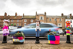 © Licensed to London News Pictures. 27/04/2016. Thirsk UK. Picture shows bollards in Thirsk that have been Yarn Bombed. Under the cover of Darkness 300 Yarn bombing street artist's have covered the Town centre of Thirsk, the group has covered bollards, flower pots, the bus stop, tree's, benches, even the local police station. The knitted creations took over 750 balls of wool & have been placed along the route of the Tour De Yorkshire which will pass through the town during it's final stage from Middlesborough to Scarborough on Sunday.  Photo credit: Andrew McCaren/LNP