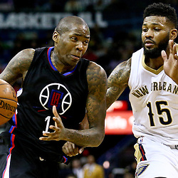 Mar 20, 2016; New Orleans, LA, USA; Los Angeles Clippers guard Jamal Crawford (11) drives past New Orleans Pelicans forward Alonzo Gee (15) during the second quarter of a game at the Smoothie King Center. Mandatory Credit: Derick E. Hingle-USA TODAY Sports