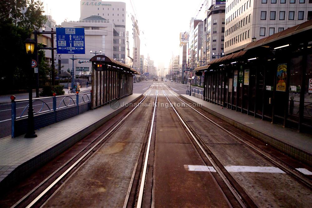 Streetcar tram tracks in downtown Hiroshima, Japan.  Light rail tracks form the backbone of the public transportation system in the city of Hiroshima.