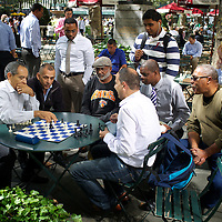 Office-workers and others play chess at lunchtime in Bryant Park, midtown Manhattan. <br />