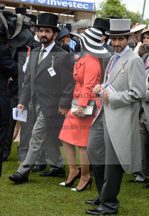 Sheikh Mohammed bin Rashid al Maktoum and his wife Princess Haya of Jordan and his son Sheikh Hamdan Bin Mohammed Bin Rashid Al Maktoum at the Investec Derby 2013 held at Epsom Racecourse, Epsom, Surrey on 1st June 2013.