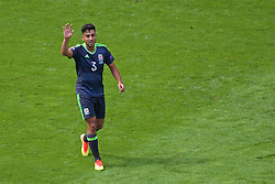 LENS, FRANCE - Thursday, June 16, 2016: Wales' Neil Taylor raises his hand as he gestures during the UEFA Euro 2016 Championship Group B match against England at the Stade Bollaert-Delelis. (Pic by Paul Greenwood/Propaganda)