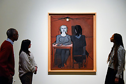 "© Licensed to London News Pictures. 19/11/2019. LONDON, UK. Staff members view a painting called ""The Conversation"", 1937, by Dora Maar. Preview of the first UK retrospective of Dora Maar (born Henriette Theodora Markovitch, 1907-97) whose photographs and photomontages became celebrated icons of surrealism.  Over 200 of her works are on display in a career spanning more than six decades at Tate Modern 20 November to 15 March 2020.  Photo credit: Stephen Chung/LNP"