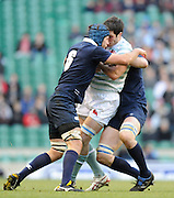 Twickenham, GREAT BRITAIN, Cambridges' Ben MAIDMent sandwiched between the Oxford tacklers during the 2010 Varsity Rugby match Oxford vs Cambridge played at the RFU Stadium Twickenham, Surrey on Thursday  09/12/2010 [Photo, Peter Spurrier/Intersport-images]