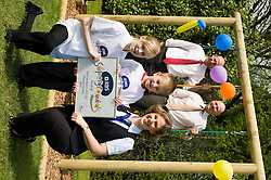 John Heeley and Mark Wheele rexecutive head teacher at Thrybergh Fullerton Church of England Primary School watch as  Royal Bank of Scotland representative Amanda Burgin presents Kyle Wilbourn and Molly Barker with RBS Supergrounds certificate.26 April 2010. Images © Paul David Drabble.