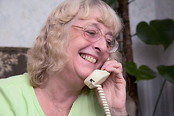 Portrait of an older woman on the phone,