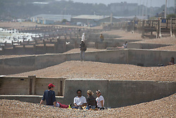 © Licensed to London News Pictures. 24/05/2020. Hastings, UK. Members of the public relax in the hot weather on Hastings seafront in East Sussex, during lockdown to prevent to spread of COVID-19.  Photo credit: Marcin Nowak/LNP