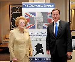 Leader of the Conservative Party David Cameron with Baroness Thatcher during the Churchill dinner, The Churchill Centre, London, UK, Tuesday October 27, 2009. Photo By Andrew Parsons / i-Images.