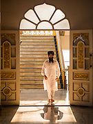 "08 FEBRUARY 2015  BANGKOK, THAILAND: A man walks into the Darbar Sahib (prayer hall) at Gurdwara Siri Guru Singh Sabha, the Sikh temple in Bangkok. Thailand has a small but influential Sikh community. Sikhs started coming to Thailand, then Siam, in the 1890s. There are now several thousand Thai-Indian Sikh families. Gurdwara Siri Guru Singh Sabha was established in 1913. Construction of the current building, adjacent to the original Gurdwara (""Gateway to the Guru""), started in 1979 and was finished in 1981. The Sikh community serves a daily free vegetarian meal at the Gurdwara that is available to people of any faith and background.    PHOTO BY JACK KURTZ"