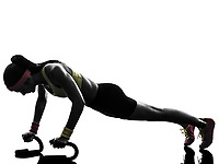 one woman exercising fitness workout push ups in silhouette on white background