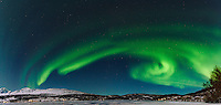 Panorama of spectacular Aurora Borealis / Northern Lights in Norway
