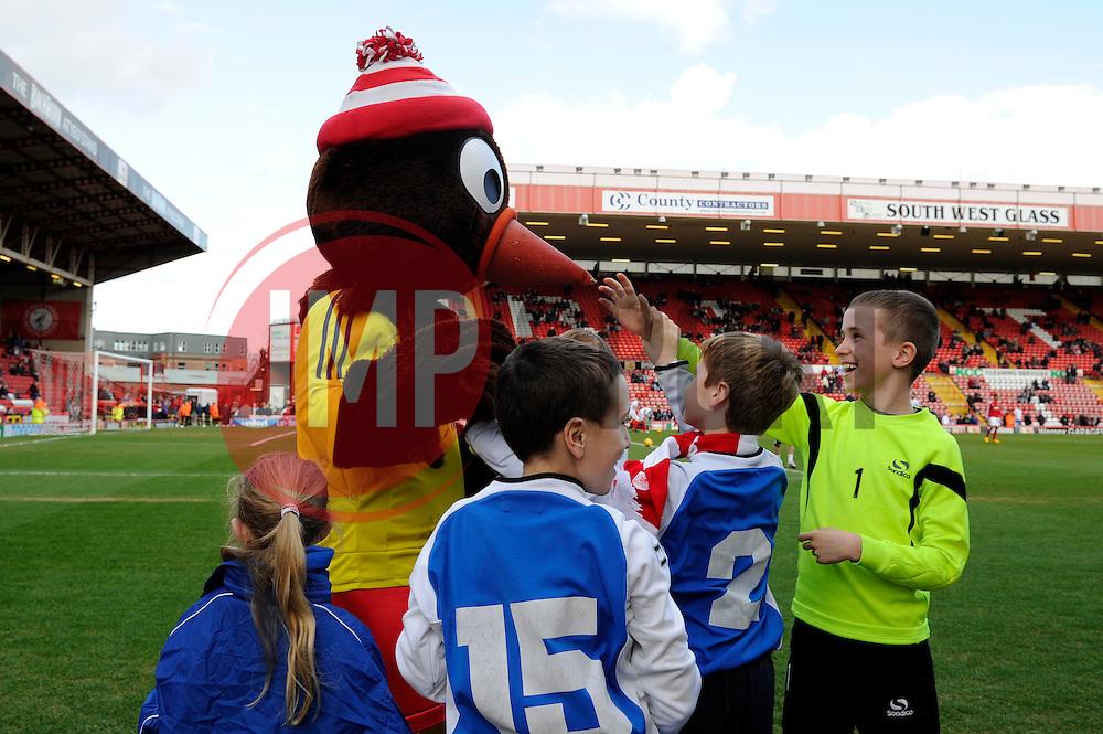 Bristol City mascot, Scrumpy interacts with some young fans - Photo mandatory by-line: Dougie Allward/JMP - Tel: Mobile: 07966 386802 01/03/2014 - SPORT - FOOTBALL - Bristol - Ashton Gate - Bristol City v Gillingham - Sky Bet League One