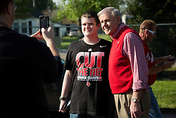 Former University of Louisville Men's head basketball coach Denny Crum poses for photos with fans after workouts Wednesday, May 01, 2013 at Churchill Downs in Louisville. Photo by Jonathan Palmer
