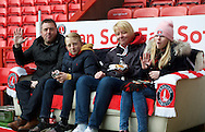 A family of Charlton Athletics fans get to watch the match on the touchline sofa during the Sky Bet Championship match at The Valley, London<br /> Picture by Alan Stanford/Focus Images Ltd +44 7915 056117<br /> 28/11/2015