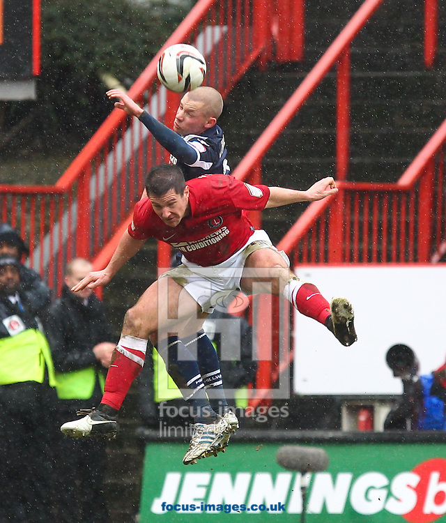 Picture by John  Rainford/Focus Images Ltd +44 7506 538356.16/03/2013.Yann Kermorgant of Charlton Athletic and Alan Dunne of Millwall during the npower Championship match at The Valley, London.