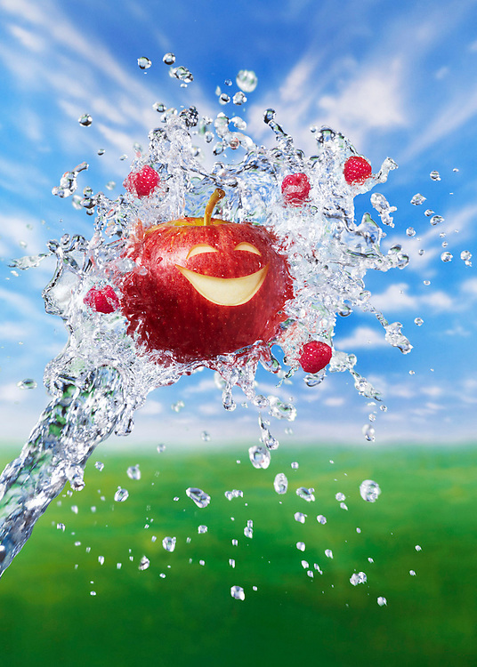 Smiling Apple and Raspberries supported in a fountain of water Ray Massey is an established, award winning, UK professional  photographer, shooting creative advertising and editorial images from his stunning studio in a converted church in Camden Town, London NW1. Ray Massey specialises in drinks and liquids, still life and hands, product, gymnastics, special effects (sfx) and location photography. He is particularly known for dynamic high speed action shots of pours, bubbles, splashes and explosions in beers, champagnes, sodas, cocktails and beverages of all descriptions, as well as perfumes, paint, ink, water – even ice! Ray Massey works throughout the world with advertising agencies, designers, design groups, PR companies and directly with clients. He regularly manages the entire creative process, including post-production composition, manipulation and retouching, working with his team of retouchers to produce final images ready for publication.
