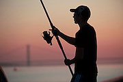 3 October 2012: A man fishing in Hull on the North bank of the Humber Estuary with the Humber Bridge in the background..Picture: Sean Spencer/Hull News & Pictures.01482 210267/07976 433960.www.hullnews.co.uk   sean@hullnews.co.uk.