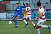 AFC Wimbledon defender Terell Thomas (6) battles for possession with Doncaster Rovers midfielder James Coppinger (26) during the EFL Sky Bet League 1 match between AFC Wimbledon and Doncaster Rovers at the Cherry Red Records Stadium, Kingston, England on 14 December 2019.