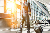 Mature pilot walking to enter the plane in boarding gate at airport