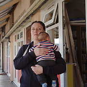 Samantha is a single mum of three children that became homeless after her landlord gave her an eviction notice. The council of Newham did not fulfil his duty to house her. She become homeless. With no-where to go, Samantha has relied on friends and family for support, coach surfing in various homes. In this photo, Samantha is holding her infant child outside her mother's flat.
