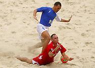 Football-FIFA Beach Soccer World Cup 2006 - Group A-Brasil - Poland, Beachsoccer World Cup 2006. Brasil`s Buru and Poland`s Saganowski- Rio de Janeiro - Brazil 03/11/2006 <br /> Mandatory credit: FIFA/ Manuel Queimadelos