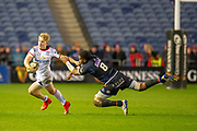 Rob Lyttle (#11) of Ulster Rugby looks to escape the clutches of Viliame Mata (#8) of Edinburgh Rugby during the Guinness Pro 14 2018_19 match between Edinburgh Rugby and Ulster Rugby at the BT Murrayfield Stadium, Edinburgh, Scotland on 12 April 2019.