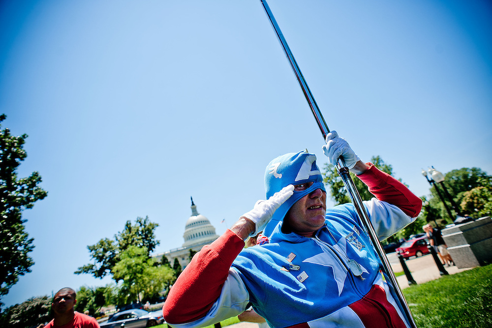 """Jim Griffin, a.k.a. """"Captain America,"""" of Ft. Washington, Md., appears at a Tea Party rally on Capitol Hill on Wednesday, July 27, 2011 in Washington. (Photo by Jay Westcott/Politico)"""