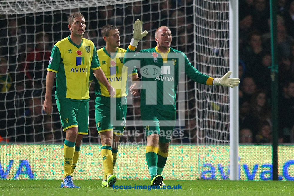 Picture by Paul Chesterton/Focus Images Ltd +44 7904 640267<br /> 09/11/2013<br /> John Ruddy of Norwich berates his defenders after Ravel Morrison of West Ham opens the scoring during the Barclays Premier League match at Carrow Road, Norwich.