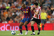 FC Barcelona's Thierry Henry (l) and Athletic de Bilbao's Andoni Iraola during the Supercup of Spain.August 23 2009.