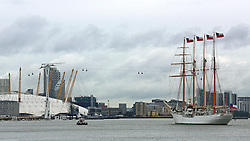 © Licensed to London News Pictures. 26/08/2015.  Sail training ship Esmerelda approaches the O2 as she arrives in the capital for a port visit. The Chilean navy vessel is over 100 metres long and has four masts.  A number of tall ships have arrived in London today in rainy weather including the Chilean navy's four masted sail training ship Esmerelda. Other ships are heading to south east London for a tall ships event which is part of the Mayor of London's Totally Thames festival. Credit : Rob Powell/LNP