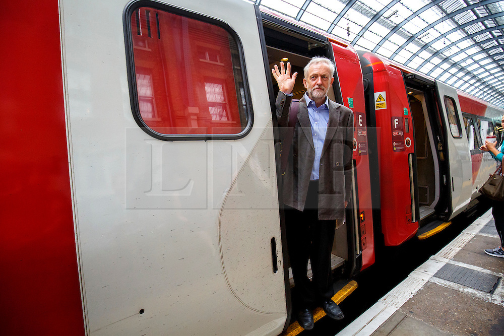 © Licensed to London News Pictures. 18/08/2015. London, UK. Labour Party leader candidate JEREMY CORBYN traveling to Middlesbrough via a Virgin train after outlining his plans for integrated publicly owned railway network at King's Cross station in London on Tuesday, August 18, 2015. Photo credit: Tolga Akmen/LNP