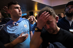 "© Licensed to London News Pictures . 07/04/2018. Manchester, UK. Manchester United pull back three goals and take the lead 2-3. Manchester City fans watch the Manchester Derby between Manchester City and Manchester United , on a live screen , at "" Manchester Bar 1 "" pub , situated directly opposite the Etihad Stadium . Photo credit : Joel Goodman/LNP"