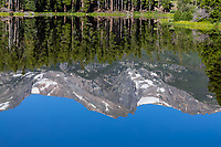 Reflections of Hallett Peak in Sprague Lake, Rocky Mountain National Park, Colorado.