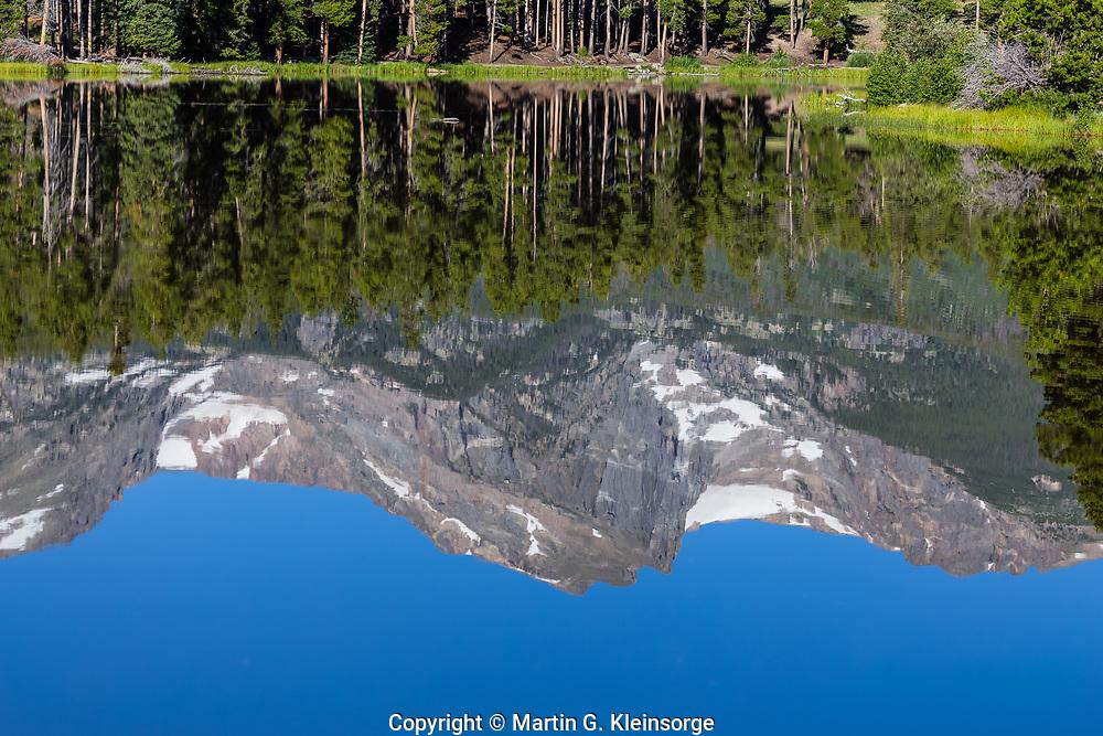 Reflections of Hallett Peak in Sprague Lake, Rocky Mountain National Park, Colorado.