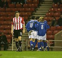Photo. Glyn Thomas.<br /> Sunderland v Birmingham. FA Cup fifth round.<br /> Stadium of Light, Sunderland. 14/02/2004.<br /> Sunderland's John Oster (L) is dejected as Birmingham celebrate their first goal.