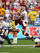Washington Redskins tight end Fred Davis (86) leaps over San Diego Chargers cornerback Dante Hughes (24) as he catches a third quarter pass good for a first and goal at the Chargers ten yard line during the NFL football game against the San Diego Chargers, January 3, 2010 in San Diego, California. The Chargers won the game 23-20. ©Paul Anthony Spinelli