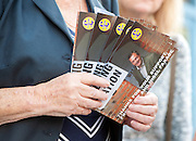 © Licensed to London News Pictures. 29/08/2014. Clacton-on-Sea, UK. A woman holds UKIP campaign leaflets. Douglas Carswell and Nigel Farage, Leader of the UK Independence Party, UKIP, meet local people on a walk about in Clacton-on-Sea today 29th August 2014. Tory Douglas Carswell  defected to UKIP and quit as MP for Clacton, saying he will contest the subsequent by-election for Nigel Farage's party.. Photo credit : Stephen Simpson/LNP