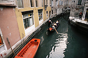 Gondola in a canal in Venice, Italy.