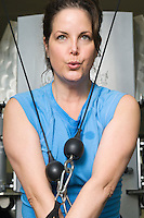 Woman Working Out on Weightlifting Machine