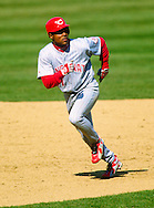 CHICAGO:  Barry Larkin of the Cincinnati Reds runs the bases during an MLB game against the Chicago Cubs at Wrigley Field in Chicago, Illinois.  Larkin played for the Reds from 1986-2004.   (Photo by Ron Vesely)   Subject: Barry Larkin.