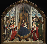Mare de Deu dels Consellers, or Virgin of the Councillors, 1445, oil painting on wood by Lluis Dalmau, 1428-61, in Gothic style, in the Museu Nacional d'Art de Catalunya, Barcelona, Spain. The painting depicts a life-size Virgin and Child seated on a Gothic throne, flanked by St Andrew and St Eulalia (patron saint of Barcelona) with their martyrdom attributes and the 5 councillors of the city of Barcelona who commissioned the altarpiece (Joan Llull, Francesc Llobet, Joan Junyent, Ramon Savall and Antoni de Vilatorta). This altarpiece originally came from the Capella de la Casa de la Ciutat, Barcelona, Spain. Picture by Manuel Cohen