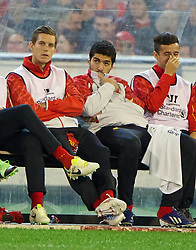 MELBOURNE, AUSTRALIA - Wednesday, July 24, 2013: Liverpool's Luis Suarez sits on the bench against Melbourne Victory during a preseason friendly match at the Melbourne Cricket Ground. (Pic by David Rawcliffe/Propaganda)