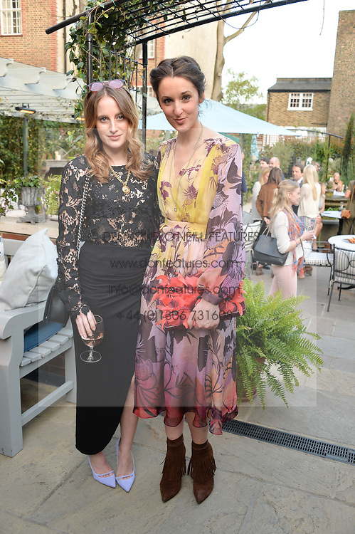 PICTURE SHOWS:-Left to right, ROSIE FORTESCUE and ROSANNA FALCONER.<br /> Tuesday 14th April 2015 saw a host of London influencers and VIP faces gather together to celebrate the launch of The Ivy Chelsea Garden. Live entertainment was provided by jazz-trio The Blind Tigers, whilst guests enjoyed Moët & Chandon Champagne, alongside a series of delicious canapés created by the restaurant's Executive Chef, Sean Burbidge.<br /> The evening showcased The Ivy Chelsea Garden to two hundred VIPs and Chelsea<br /> residents, inviting guests to preview the restaurant and gardens which marry<br /> approachable sophistication and familiar luxury with an underlying feeling of glamour and theatre. The Ivy Chelsea Garden's interiors have been designed by Martin Brudnizki Design Studio, and cleverly combine vintage with luxury, resulting in a space that is both alluring and down-to-earth.