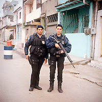 Patrol Officers Dilma Carvalho, 32, and Carla Bonn, 33, right.<br /> Rapid Response Team<br /> Pacifying Police Unit<br /> Complexo do Caju, Rio de Janeiro, Brazil