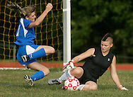 Port Jervis goalie Kathleen Kehlenbeck comes out of the goalie to grab the ball before Valley Central's Courtney McGowan  can take a shot during a game in Port Jervis on Tuesday, Sept. 15, 2009.