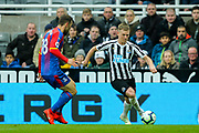 Matt Ritchie (#11) of Newcastle United takes on James McArthur (#18) of Crystal Palace during the Premier League match between Newcastle United and Crystal Palace at St. James's Park, Newcastle, England on 6 April 2019.