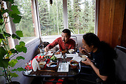 Takeshi Hanatani and Shun Adachi having lunch while Nyanbo is sleeping, Alaska, USA.