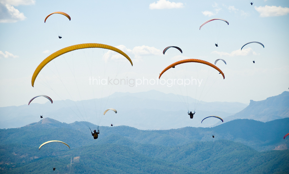 Paragliders just after launch during a competition, Valle de Bravo, Mexico.