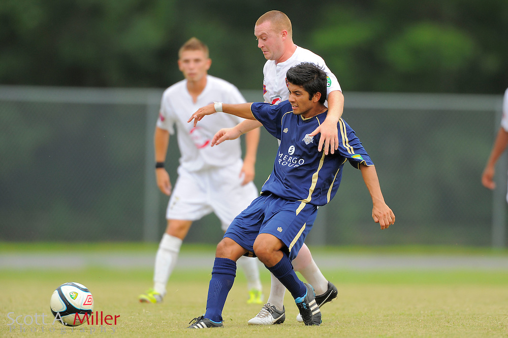 Orlando City midfielder Sam Fairhurst (16) and Austin Aztex midfielder Pedro Pereira (10) fight for a ball during City's 4-1 win over the Aztex in the PDL Southern Conference Championships final at Trinity Catholic High Schooll on July 22, 2012 in Ocala, Florida. ..©2012 Scott A. Miller